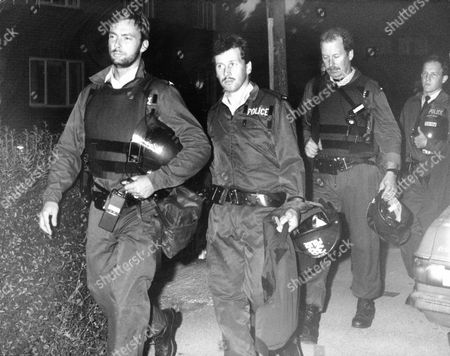 Police Marksmen Wearing Protective Clothing In Hungerford. The Hungerford Massacre On 19 August 1987. The Gunman 27-year-old Michael Robert Ryan Armed With Two Semi-automatic Rifles And A Handgun Shot And Killed Sixteen People Including His Mother And Wounded Fifteen Others Then Fatally Shot Himself. Taken From Book 'true Crime' Classic Rare And Unseen. Published By Trans Atlantic Press 2009.
