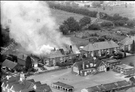 Burning House At Hungerford Berkshire. Gunman Michael Ryan Set His Home 4 South View On Fire Midway Through His Shooting Spree. The Hungerford Massacre On 19 August 1987. The Gunman 27-year-old Michael Robert Ryan Armed With Two Semi-automatic Rifles And A Handgun Shot And Killed Sixteen People Including His Mother And Wounded Fifteen Others Then Fatally Shot Himself. Taken From Book 'true Crime' Classic Rare And Unseen. Published By Trans Atlantic Press 2009.