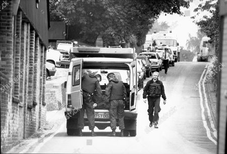 Armed Police And Ambulances On The Streets Of Hungerford As Michael Ryan Shoots 16 Dead. The Hungerford Massacre On 19 August 1987. The Gunman 27-year-old Michael Robert Ryan Armed With Two Semi-automatic Rifles And A Handgun Shot And Killed Sixteen People Including His Mother And Wounded Fifteen Others Then Fatally Shot Himself. Taken From Book 'true Crime' Classic Rare And Unseen. Published By Trans Atlantic Press 2009.
