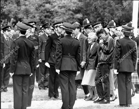 The Funeral Of Pc Roger Brereton - Shot By Michael Ryan In Hungerford - At St Mary's Church Shaw Newbury Berkshire. Relatives And Colleagues Of Brereton Including His Sons Sean (18) And Paul (18) The Hungerford Massacre On 19 August 1987. The Gunman 27-year-old Michael Robert Ryan Armed With Two Semi-automatic Rifles And A Handgun Shot And Killed Sixteen People Including His Mother And Wounded Fifteen Others Then Fatally Shot Himself. Taken From Book 'true Crime' Classic Rare And Unseen. Published By Trans Atlantic Press 2009.