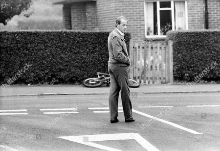 John Storms Stands On The Spot In Hungerford Where He Was Shot By Michael Ryan. 49 Yr Old John Storms Was Shot In The Face By Ryan As He Drove Through Hungerford. He Was Rescued By Bob Barclay Who Lived Across The Road The Hungerford Massacre On 19 August 1987. The Gunman 27-year-old Michael Robert Ryan Armed With Two Semi-automatic Rifles And A Handgun Shot And Killed Sixteen People Including His Mother And Wounded Fifteen Others Then Fatally Shot Himself. Taken From Book 'true Crime' Classic Rare And Unseen. Published By Trans Atlantic Press 2009.