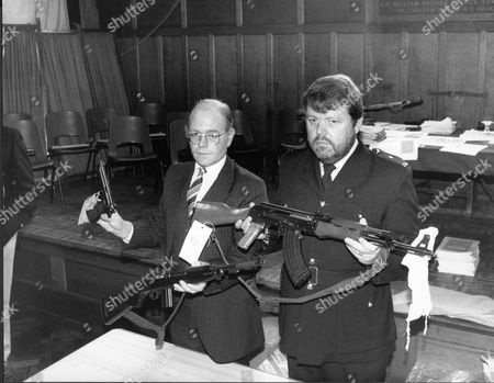 Stock Image of Killer Michael Ryan's Guns Being Held By Pc Colin Lilley And Inspector Laurie Fray Type 56 Assault Rifle M1 Carbine Beretta 92fs The Hungerford Massacre On 19 August 1987. The Gunman 27-year-old Michael Robert Ryan Armed With Two Semi-automatic Rifles And A Handgun Shot And Killed Sixteen People Including His Mother And Wounded Fifteen Others Then Fatally Shot Himself. Taken From Book 'true Crime' Classic Rare And Unseen. Published By Trans Atlantic Press 2009.