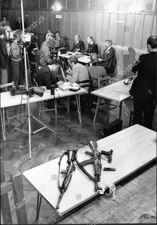 Killer Michael Ryan's Guns At The Hungerford Press Conference Type 56 Assault Rifle M1 Carbine Beretta 92fs The Hungerford Massacre On 19 August 1987. The Gunman 27-year-old Michael Robert Ryan Armed With Two Semi-automatic Rifles And A Handgun Shot And Killed Sixteen People Including His Mother And Wounded Fifteen Others Then Fatally Shot Himself. Taken From Book 'true Crime' Classic Rare And Unseen. Published By Trans Atlantic Press 2009.