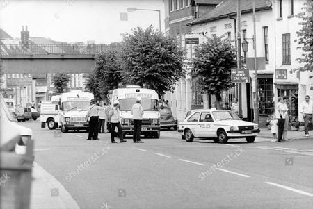 Hungerford High Street Showing Police And Ambulances - Taken Shortly After Michael Ryan's Killing Spree. The Hungerford Massacre On 19 August 1987. The Gunman 27-year-old Michael Robert Ryan Armed With Two Semi-automatic Rifles And A Handgun Shot And Killed Sixteen People Including His Mother And Wounded Fifteen Others Then Fatally Shot Himself. Taken From Book 'true Crime' Classic Rare And Unseen. Published By Trans Atlantic Press 2009.
