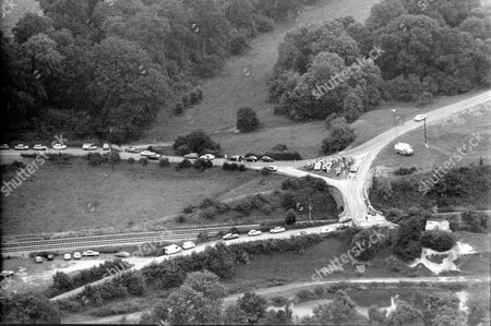 Aerial View Of Hungerford Cordoned Of By Police During The Shooting Sprees Of Michael Ryan The Hungerford Massacre On 19 August 1987. The Gunman 27-year-old Michael Robert Ryan Armed With Two Semi-automatic Rifles And A Handgun Shot And Killed Sixteen People Including His Mother And Wounded Fifteen Others Then Fatally Shot Himself. Taken From Book 'true Crime' Classic Rare And Unseen. Published By Trans Atlantic Press 2009.