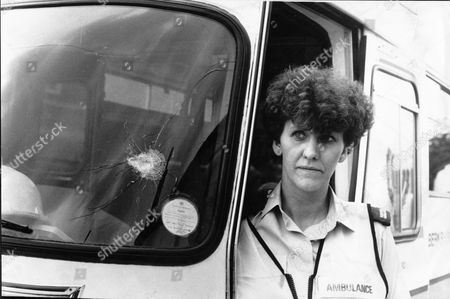 Ambulance Woman Linda Bright Showing Bullet Hole In Windscreen Of Her Ambulance. Michael Ryan Fired On The Ambulance As Linda And Her Colleague Hazel Haslett Tried To Tend To One Of His Victims The Hungerford Massacre On 19 August 1987. The Gunman 27-year-old Michael Robert Ryan Armed With Two Semi-automatic Rifles And A Handgun Shot And Killed Sixteen People Including His Mother And Wounded Fifteen Others Then Fatally Shot Himself. Taken From Book 'true Crime' Classic Rare And Unseen. Published By Trans Atlantic Press 2009.