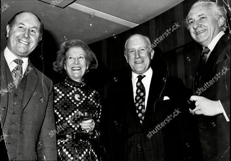 Stock Photo of Sir Desmond Plummer Baron Plummer Of Marylebone (3rd Left) With Baroness Plummer Of Marylebone And Brian Harper (left) And Tv Personality Hughie Green (right) Arthur Desmond Herne Plummer Baron Plummer Of St Marylebone (known As Desmond Plummer) (25 May 1914 A 2 October 2009) Was A Conservative Party Politician In London And The Longest Serving Leader Of The Greater London Council. Plummer Went To Hurstpierpoint College And The College Of Estate Management. He Qualified As A Surveyor But His Career Was Curtailed By World War Ii Where He Served With The Royal Engineers Leaving With The Rank Of Major. In 1950 He Was Awarded The Territorial Decoration For Long Service In The Territorial Army And He Was A Member Of The Territorial Army Sports Board From 1953 Until 1979. Plummer Was Elected To St. Marylebone Borough Council In May 1952 And Served As Mayor Of The Borough In 1958. He Was Selected As A Conservative Candidate For A Byelection To The London County Council In St. Marylebone In 1960 And Returned Unopposed For The Safe Seat. He Was Elected To Its Successor The Greater London Council In 1964 For The City Of Westminster. By 1966 Plummer Was Chosen As Leader Of The Opposition In Succession To Sir Percy Rugg Just A Year Before The Glc Elections. With Harold Wilson's Labour Government Growing Ever More Unpopular He Won A Landslide Victory In 1967. Plummer's Glc Pioneered The Sale Of Council Housing And Negotiated From The Government The Power To Run The London Underground And The Rest Of London Transport In 1969. The Conservatives Were Re-elected Under Plummer In 1970 A Few Weeks Before The General Election Although Labour Regained Control Of The Inner London Education Authority. Plummer Was The Only Leader Of The Glc To Get A Second Term. He Was Knighted In 1971.