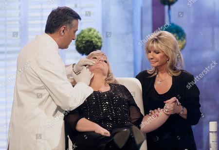 Stock Image of Dr Khan and Lesley Reynolds Khan with Linda Nolan