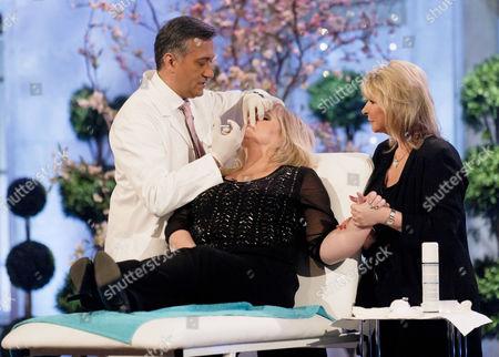 Stock Photo of Dr Khan and Lesley Reynolds Khan with Linda Nolan