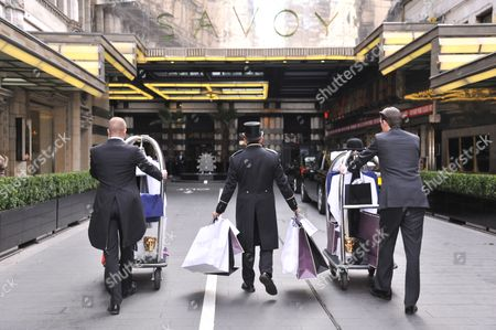 Doormen taking clothing and products into the hotel ... & Doormen Stock Pictures Editorial Images and Stock Photos   Shutterstock