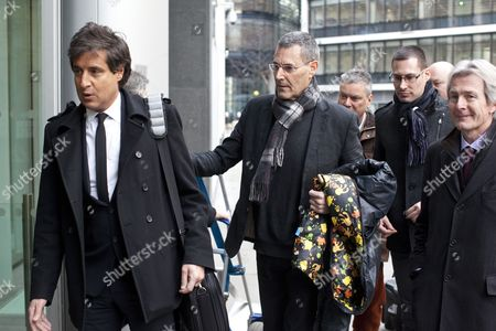 Uri Geller (centre holding colourful jacket) next to (left) David Sherborne QC