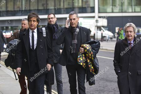 Uri Geller (centre on telephone) next to (left) David Sherborne QC