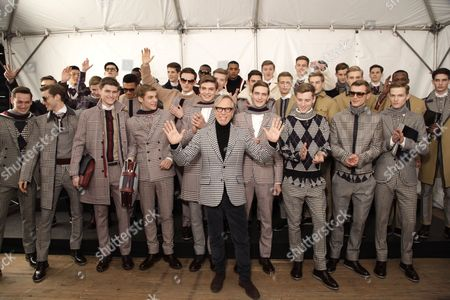 Stock Picture of Tommy Hilfiger and Henry Pedro-Wright (4th from left with sunglasses) models backstage