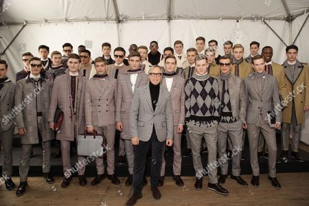 Tommy Hilfiger and Henry Pedro-Wright (3rd from left, 2nd row, sunglasses) models backstage