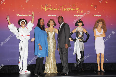 Whitney's brother Gary Houston and sister in-law Pat Houston with Wax figures of Whitney Houston