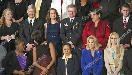 Top row, left to right: Deb Carey, Tim Cook, Amanda McMillan, Lt. Brian Murphy, Marie Lopez Rogers, and Bradley Henning; Bottom row, left to right: Cleopatra Pendleton, first lady Michelle Obama, Menchu Sanchez, Dr. Jill Biden, and Kaitlin Roig