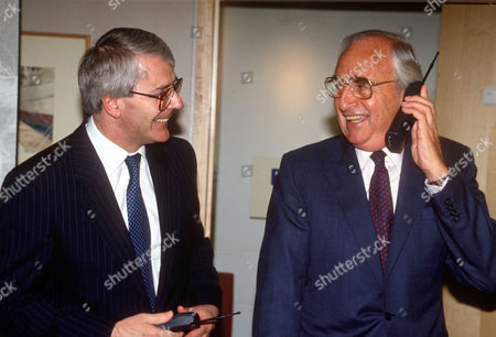 JOHN MAJOR AND LORD YOUNG ON A MOBILE TELEPHONE