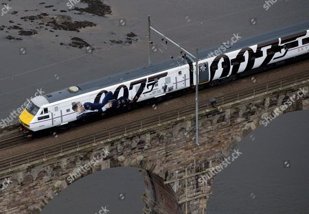 Stock Image of The newly unveiled Skyfall train travels across the Royal Border Bridge in Berwick Upon Tweed.