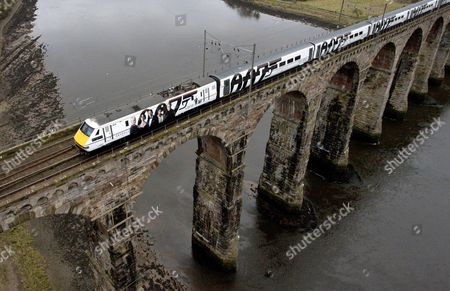 Stock Photo of The newly unveiled Skyfall train travels across the Royal Border Bridge in Berwick Upon Tweed.