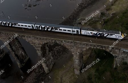 The newly unveiled Skyfall train travels across the Royal Border Bridge in Berwick Upon Tweed.