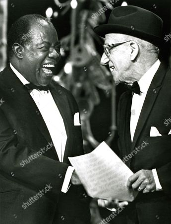 New York City, 1965 - 'trumpeter Louis Armstrong (Left) Exchanges A Laugh With Veteran Comedian Jimmy Durante As They Rehearse In New York City For A National Television Show Honoring Mr. Armstrong For His 50 Years In Show Business. Armstrong, Who Will Be 65 On July 4, 1965, Began His Professional Career As A Trumpeter With A Jazz Band In New Orleans. Prior To That, He Had Led A Band In An Orphan's Home In The City. Durante, 72, Started His Career In Show Business 55 Years Ago.' Photographer Unknown