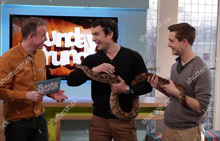 Tim Lovejoy with Niall McCann and Kendra a 10ft Python
