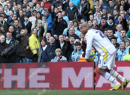 Manchester City fans gesture abuse at El-Hadji Diouf of Leeds United