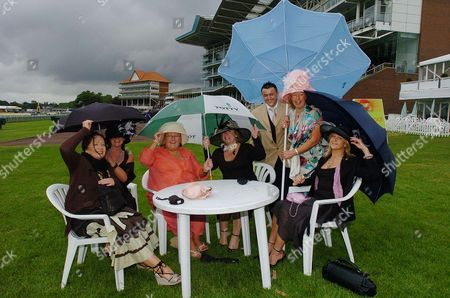 Ladies Day At Royal Ascot Horse Racing Meeting Which Is Being Held At York Because Of A New Stand Being Built At Ascot. Braving The Weather (l To R) Susan Sharp (a Pa From Bradford) Jan Hatfield (a Beauty Therapist) Barbara Breadbury Kay Beaumont Noel Robinson (a Hairdresser) Sally Ackroyd (a Hairdresser From Leeds) And Beverley Kemp From Leeds.