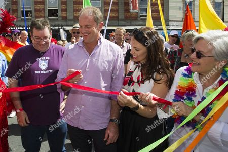Stock Image of Labour Leader David Shearer and MP Jacinda Arden cut a red ribbon before taking part in the Pride Parade.