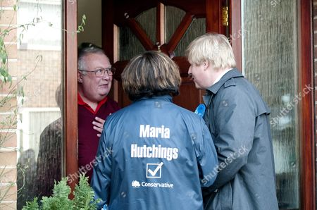 Conservative candidate Maria Hutchings and London Mayor Boris Johnson canvassing voter Ian Patrick