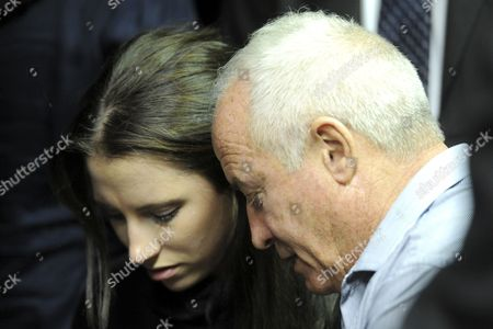 Oscar Pistorius's sister and father, Aimee Pistorius and Henke Pistorius during his bail hearing in the Pretoria Magistrate Court