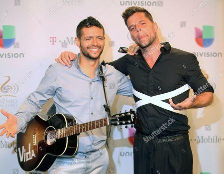 Robi Draco Rosa and Ricky Martin