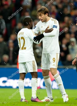 Nathan Dyer of Swansea City argues with Miguel Perez Cuesta of Swansea City about who will take the penalty