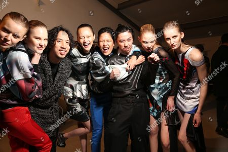 Designers Eri and Philip Chu with models backstage