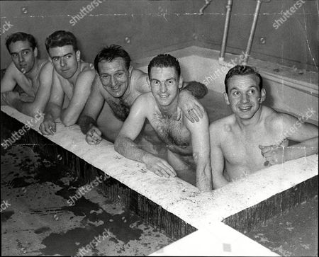 Editorial picture of Football Team Groups Walsall Players In The Bath L-r Johnny Davies Roy Faulkner Harry Haddington Ken Hodgkinson And Peter Billingham.