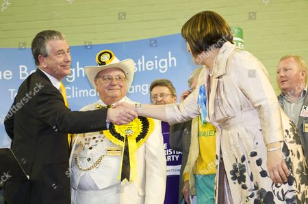 Liberal Democrat candidate Mike Thornton shaking hands with Conservative candidate Maria Hutchings after finding out that he has won