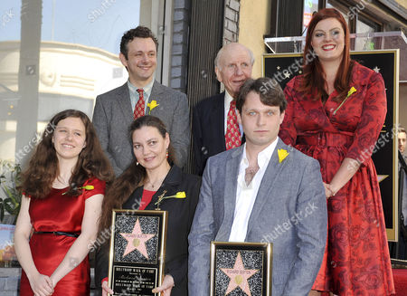 (Front row from left) Charlotte Ritchie, Maria Burton, Morgan Ritchie, and (back from from left) actor Michael Sheen and Lord David Rowe-Beddoe