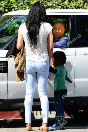 Kimora Lee Simmons and Kenzo Lee Hounsou and Russell Simmons