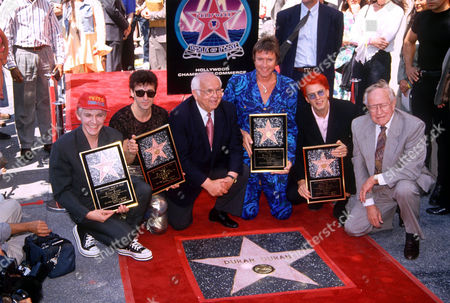 Stock Picture of Duran Duran - Nick Rhodes, Warren Cuccurullo, Simon Le Bon and John Taylor with Johnny Grant (c), receive a star on the Hollywood Walk Of Fame