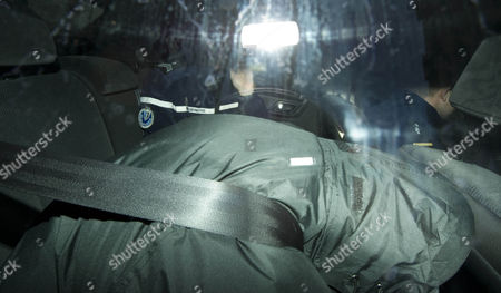 Coach Crash Driver Derek Thompson Hides In The Back Of A Police Car As He Is Driven In The Rear Entrance To Palais-du-justice This Evening In Chalon-en-champagne France. Picture By James Emmett. 20/2/2012.