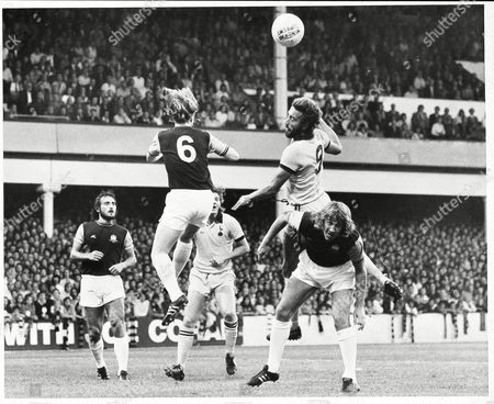 Spurs Martin Chivers Leaps Above Tommy Taylor To Challenge Kevin Lock (6) And Heads Over The Bar. Frank Lampard Looks On (left). West Ham United V Tottenham Hotspur (1-0) Division 1 At Upton Park.