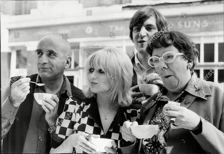 Actress And Singer Adrienne Posta 'the Garnett Saga' L-r Actor Warren Mitchell Adrienne Posta Dandy Nichols And At The Back Paul Angelis Adrienne Posta (born Adrienne Luanne Poster 4 March 1949) Is An English Film And Television Actress And Singer Prominent During The 1960s And 1970s. She Adopted The Surname Posta In 1966. She Recorded A Number Of Singles. She Is Now Semi-retired And Works As A Teacher In The Midlands And At The Italia Conti Academy Of Theatre Arts. Posta Is An Honorary Patron Of The Music Hall Guild Of Great Britain And America.
