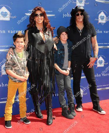 Stock Photo of Slash, wife Perla Ferrar and family