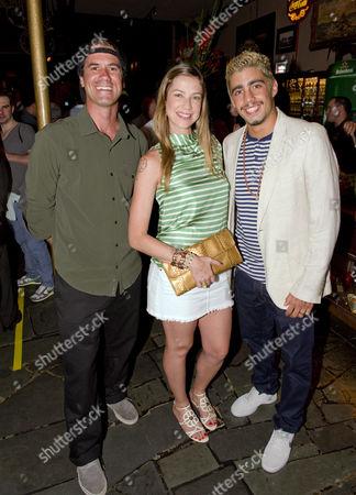 Stock Image of Bob Burnquist with Luana Piovani and Pedro Scooby