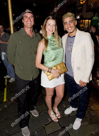 Stock Picture of Bob Burnquist with Luana Piovani and Pedro Scooby