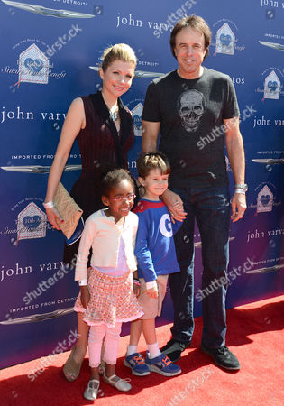 Stock Picture of Kevin Nealon, Susan Yeagley and son Gable Ness