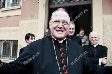 Cardinal Timothy Michael Dolan leaving the Church Nostra Signora Di Guadalupe after officiating the Mass