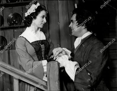 Stock Picture of Actor Tyrone Power With Actress Clare Austin In Play 'the Devils Disciple' Tyrone Edmund Power Jr. (may 5 1914 Oo November 15 1958) Was An American Film And Stage Actor. From 1930s To The 1950s Power Appeared In Dozens Of Films Often In Swashbuckler Roles Or Romantic Leads. His Better-known Films Include The Mark Of Zorro Blood And Sand The Black Swan Prince Of Foxes The Black Rose And Captain From Castile. Though Largely A Matinee Idol Known For His Good Looks Power Starred In Films From A Number Of Genres From Drama To Light Comedy. In The 1950s He Began Placing Limits On The Number Of Films He Would Make In Order To Have Time For The Stage. He Received His Biggest Accolades As A Stage Actor In John Brown's Body And Mister Roberts. Power Died From A Heart Attack At The Age Of 44.