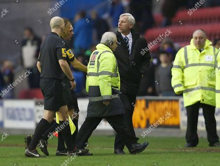 Newcastle United manager Alan Pardew has a word with referee Mr Mark Halsey at the end of the game