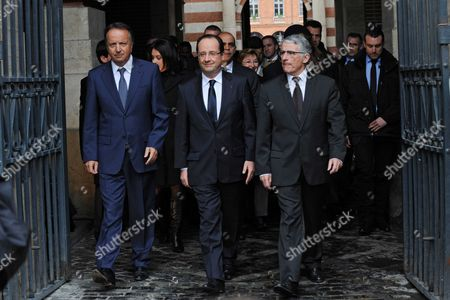 Francois Hollande flanked by Toulouse mayor Pierre Cohen and Jean-Pierre Bel